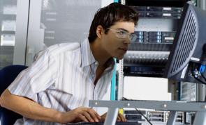 IT Worker Using Computer in Server Room